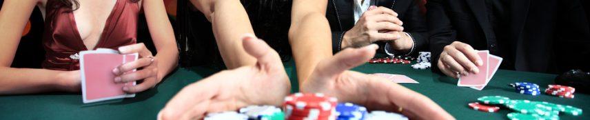 Men and women playing casino games